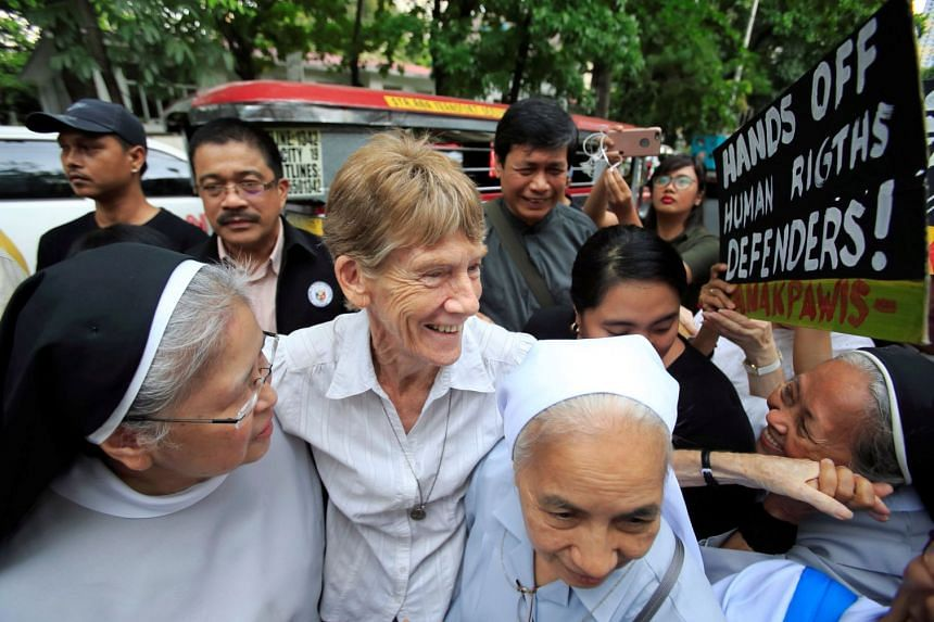 Australian Patricia Fox flanked by her fellow nuns ahead of filing a petition against her deportation in Manila yesterday.