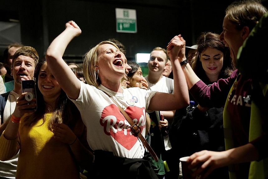 """Campaigners for change, wearing """"Repeal"""" jumpers and """"Yes"""" badges, gathered at the main Dublin count centre. """"Yes"""" campaigners argued that with over 3,000 women travelling to Britain each year for terminations and others ordering pills illegally onli"""
