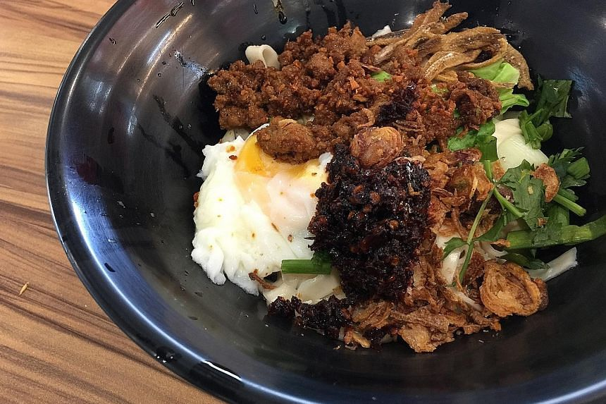 The signature chilli ban mian includes minced pork, meatballs, ikan bilis, wongbok cabbage, an egg and a dollop of chilli.