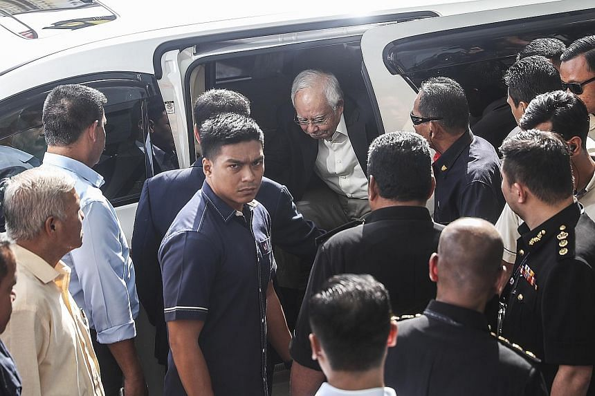 Former Malaysian prime minister Najib Razak arriving at the Malaysian Anti-Corruption Commission's headquarters in Putrajaya last Thursday to answer investigators' questions on SRC International, a former subsidiary of troubled state fund 1MDB. Mr Na