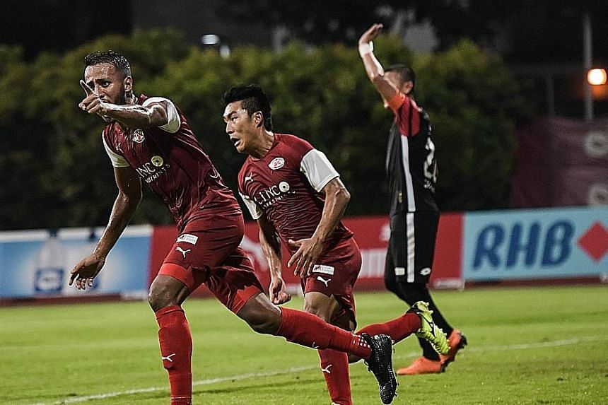 Home's Abdil Qaiyyim cheering after Song Ui Yong (behind him) scored their second goal. The team won for the first time in four games.