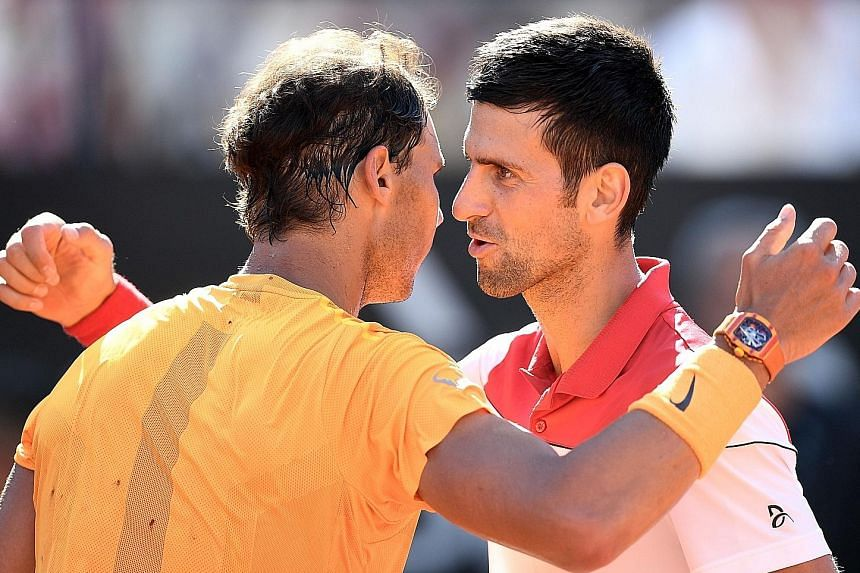 Rafael Nadal (left) is congratulated by Novak Djokovic after the world No. 1 won a hard-fought semi-final in Rome on May 19. They can meet in Paris only in the final.