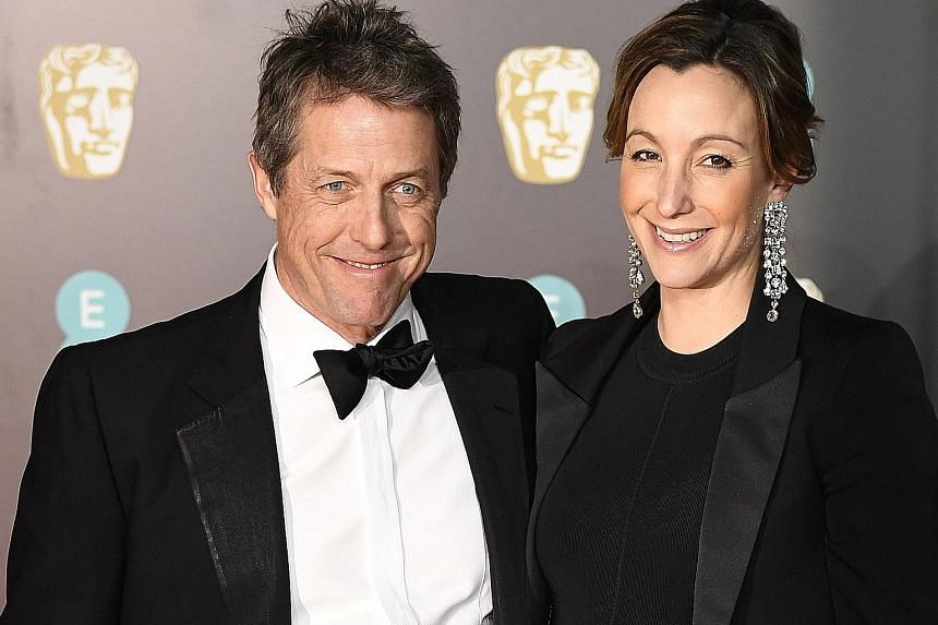 British actor Hugh Grant and producer Anna Eberstein in a February photo. Grant, who has played a string of commitment-phobic characters, married Eberstein at a low-key civil ceremony in London last Friday.