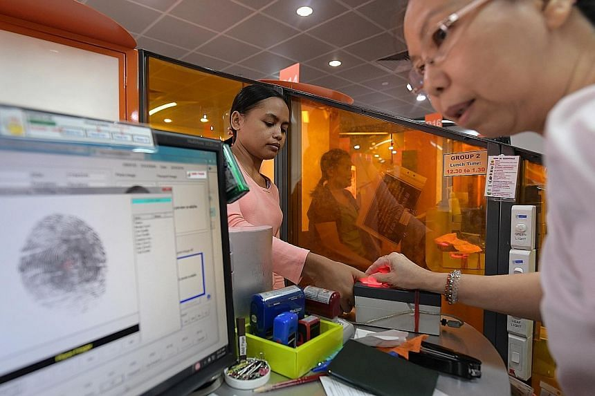 A new maid having her thumb print taken during registration for her work permit at the MOM Services Centre last Tuesday. As of last year, Singapore has 240,000 maids. New maids attending a Settling-In Programme. Last year, the Manpower Ministry punis
