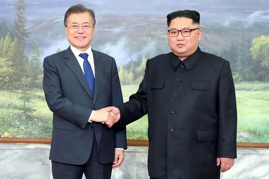 South Korea's President Moon Jae In (left) with North Korean leader Kim Jong Un before their second summit at the north side of the truce village of Panmunjom, in the demilitarised zone on May 26, 2018.