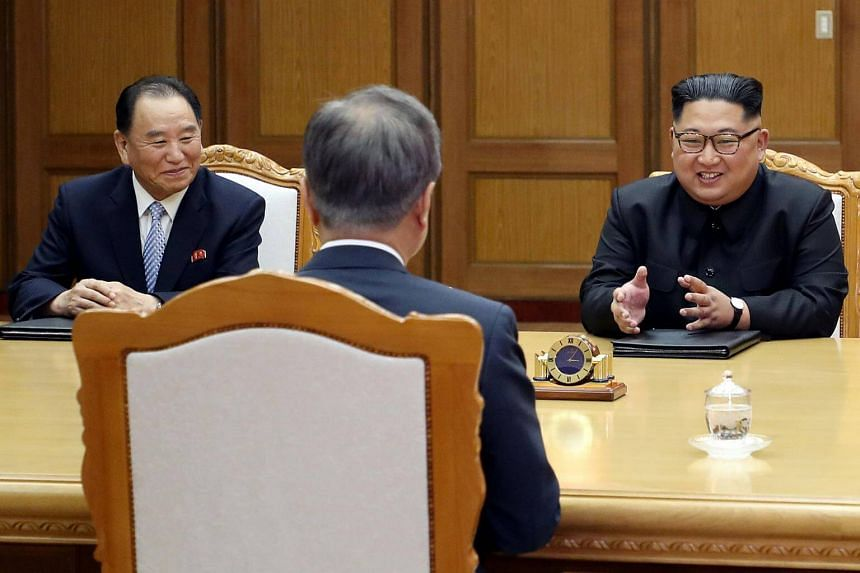 South Korean President Moon Jae In (centre) and North Korean leader Kim Jong Un (right) during their summit at the truce village of Panmunjom, North Korea, on May 26, 2018.