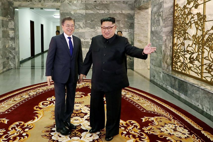 South Korean President Moon Jae In (left) is greeted by North Korean leader Kim Jong Un during their summit at the truce village of Panmunjom, North Korea, on May 26, 2018.