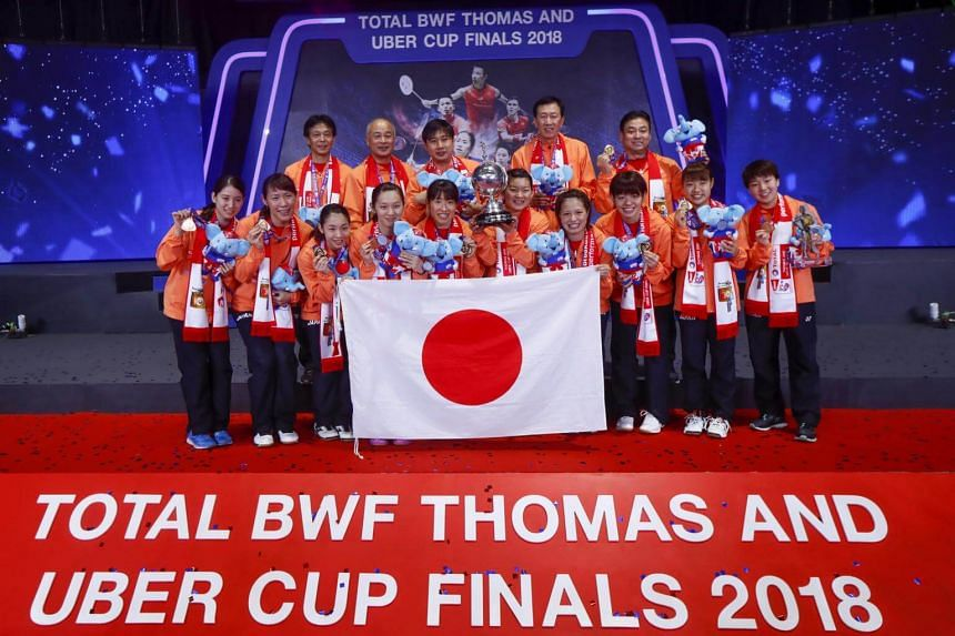 Team Japan pose on the podium with their trophy after winning the Uber Cup Finals 2018 badminton match against team Thailand at the Thomas and Uber Cup 2018 in Bangkok, on May 26, 2018.