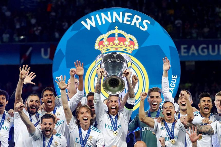 Real Madrid players celebrate winning the Uefa Champions League final football match on May 26, 2018.