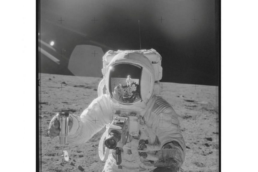 Astronaut Alan Bean holds a Special Environmental Sample Container filled with lunar soil collected during the Apollo 12 mission in this Nasa handout photo provided on Nov 19, 1969.