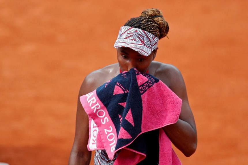 Former world number one Venus Williams was well short of her best as China's Wang Qiang claimed a 6-4, 7-5 victory and gained a measure of revenge for her first-round loss to Venus at Roland Garros last year.