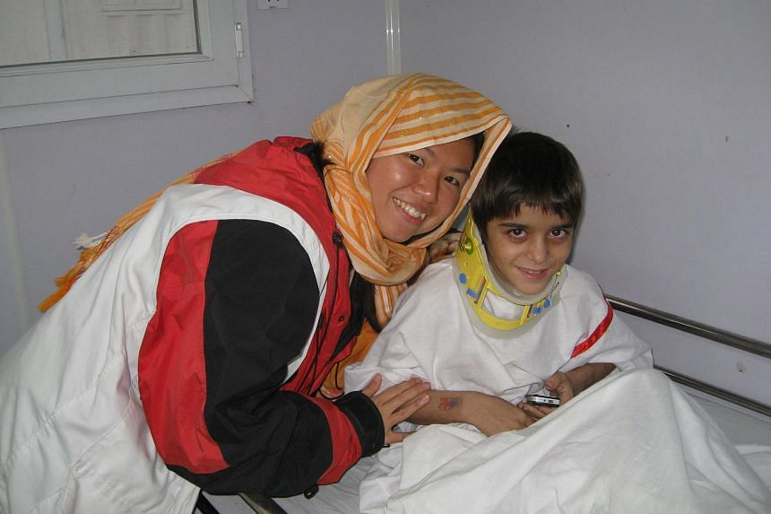 Miss Lim Suet Fong with a patient she was working with in Afghanistan while serving with Doctors Without Borders.