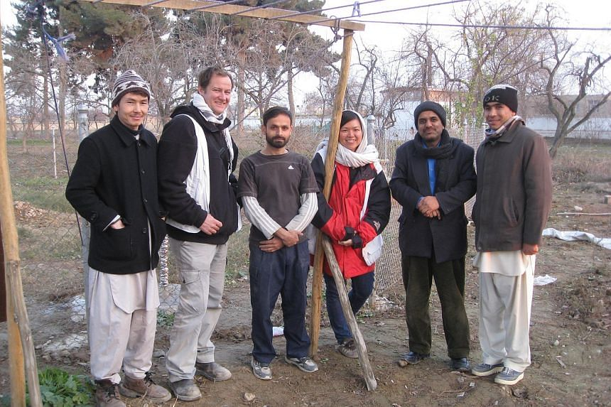Miss Lim Suet Fong with her logistics team while she was a field worker with Doctors Without Borders in Afghanistan. She is one of the non-medical fieldworkers in the organisation.