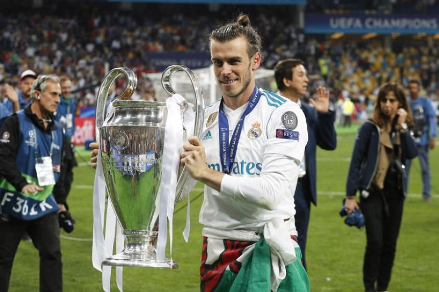 Real Madrid's Gareth Bale celebrates with the trophy after the UEFA Champions League final between Real Madrid and Liverpool FC on May 26, 2018.