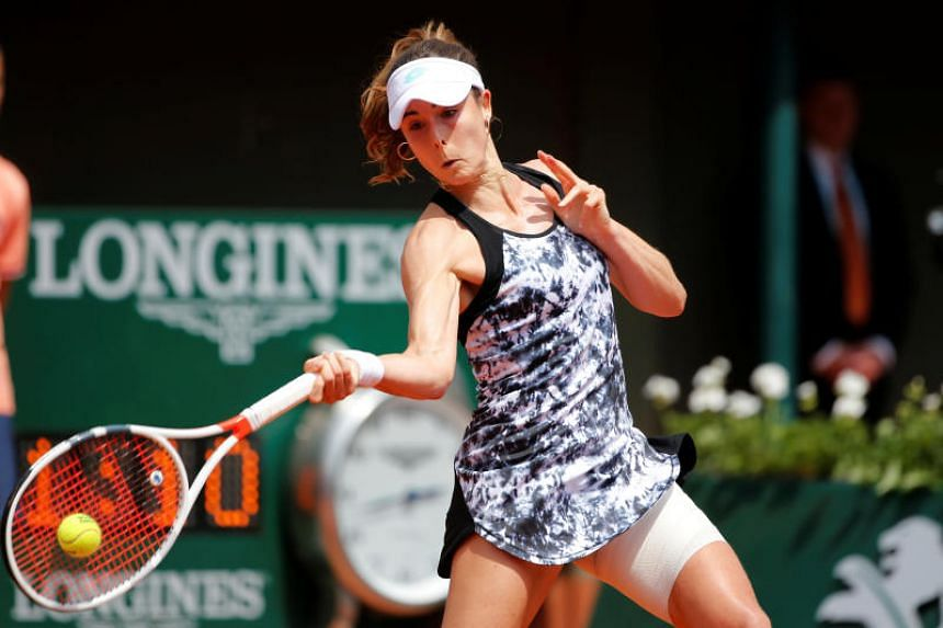 France's Alize Cornet in action during her first round match against Italy's Sara Errani.