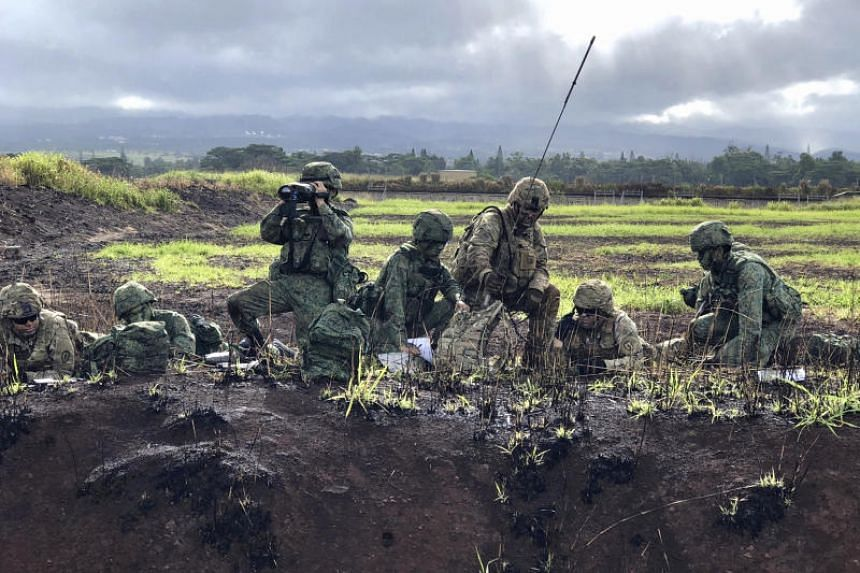 SAF and US Army soldiers observing their targets in support of an infantry assault during a live-fire exercise at Exercise Tiger Balm 2018.