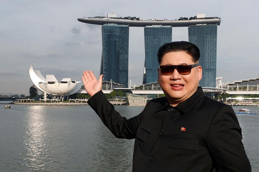 Howard X, an Australian-Chinese man known for portraying North Korean leader Kim Jong Un, posing in front of Marina Bay Sands on May 27, 2018.