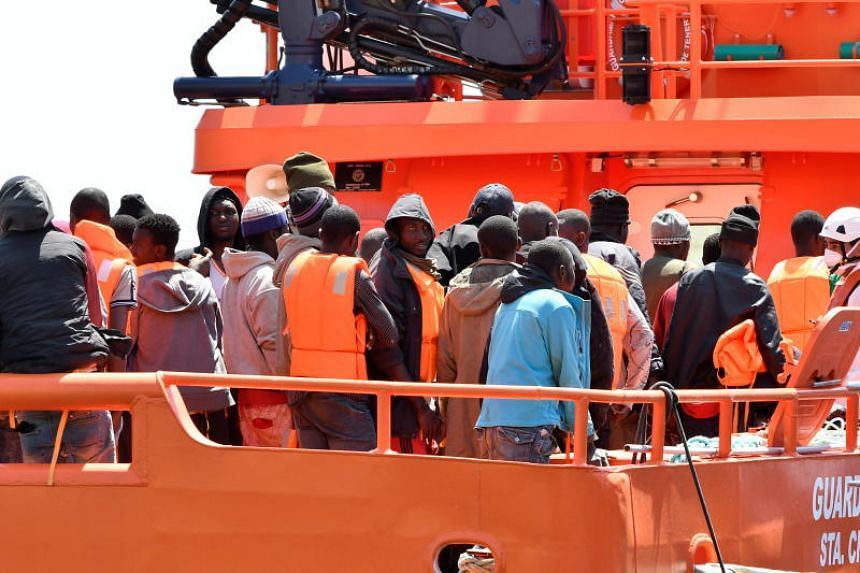 Maritime Rescue Services help some of 76 immigrants as they arrive at the port in Almeria, Andalusia, Spain, on May 26, 2018.