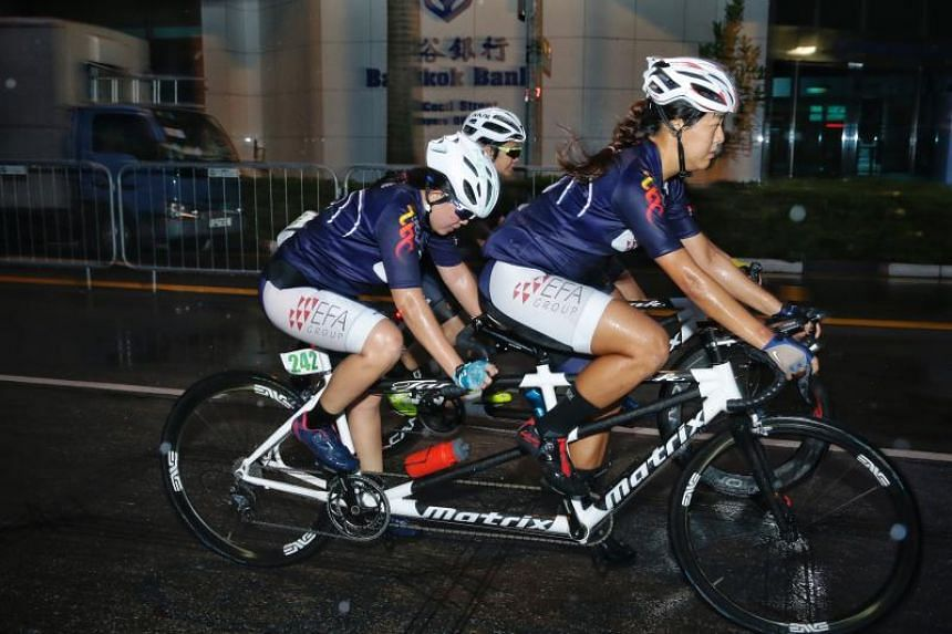 Para-cyclist Emily Lee (left) and pilot Sarah Tan racing in tandem during the Singapore International Para-cycling Cup on May 27, 2018