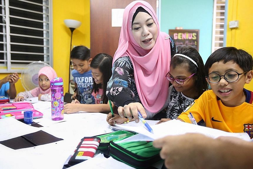 Madam Nurhidayah Mohamed Ismail, who runs Genius Young Minds, with a Primary 6 maths tuition class. She said her tuition centre started with a class of 10 pupils in 2013 and expanded to nearly 200 children across two branches.