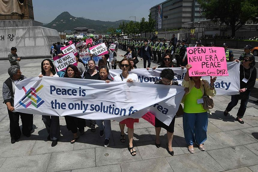 Peace activists marching during a rally against US President Donald Trump in Seoul last Friday. Mr Trump had called off a summit with North Korean leader Kim Jong Un that would have been held in Singapore on June 12. Hopes for the summit have since b