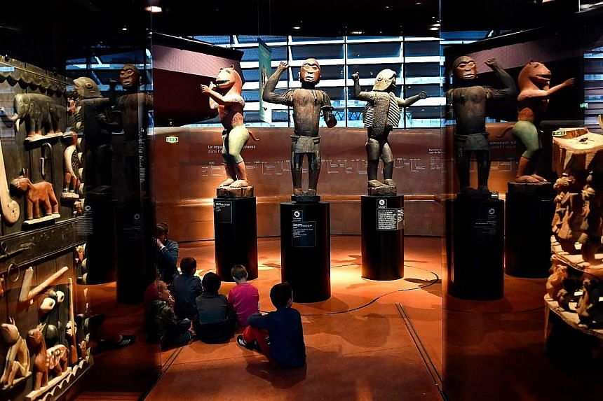 Statues from the kingdom of Dahomey (present-day Benin) on display at the Quai Branly Museum in Paris. Benin is demanding the return of its national treasures.