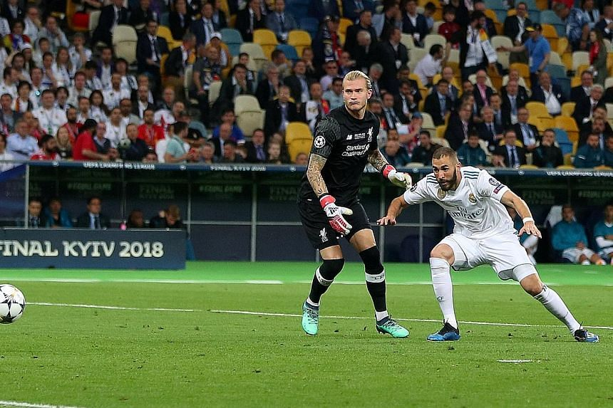 Karim Benzema scoring Real Madrid's first goal after Loris Karius threw the ball in front of him. Karius looking on as Gareth Bale's long-range shot slips past his flapping hands for Real Madrid's third goal.