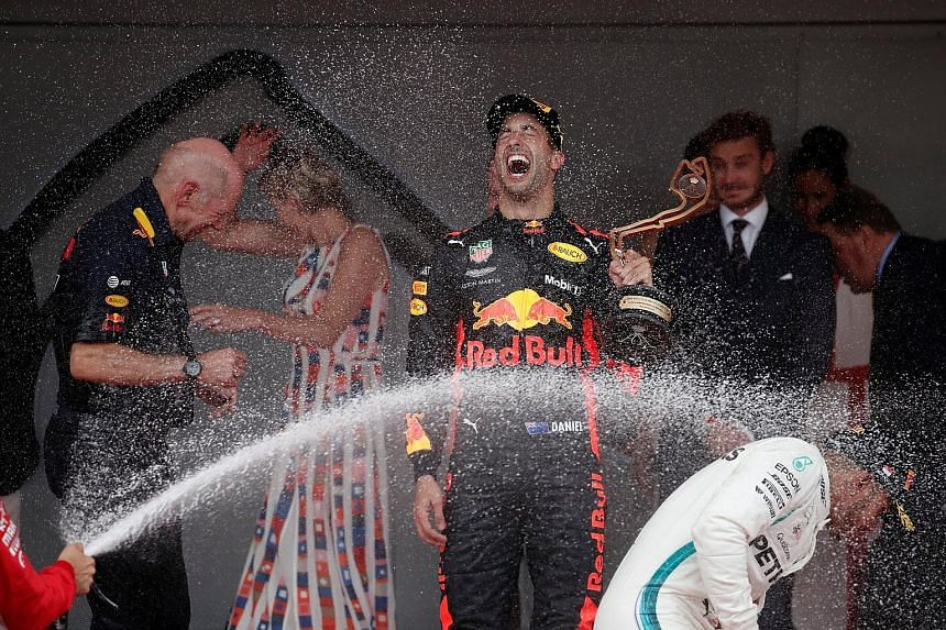 Monaco race winner Daniel Ricciardo is on a high after receiving his trophy, as runner-up Sebastian Vettel joins in the fun by spraying champagne on third-placed Lewis Hamilton.