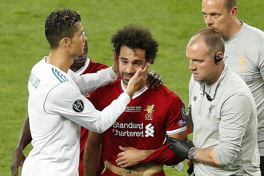 Real Madrid's Cristiano Ronaldo consoling a tearful Mohamed Salah before the Liverpool forward was substituted with a shoulder injury in the 31st minute of the Champions League final at the Olympic Stadium in Kiev, Ukraine on Saturday. Real won 3-1 f