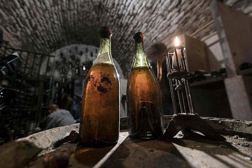 "A bottle of Jura wine dating back to 1774 has sold for a record €103,700 (S$162,200) at auction in France, while two others of the same vintage also touched new highs. ""I didn't think that these bottles would sell for so much. The last record set i"