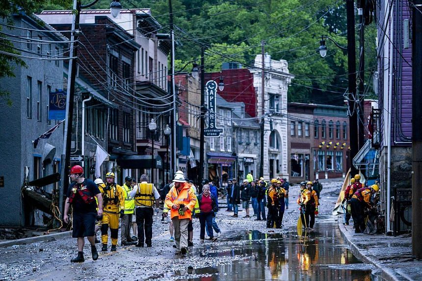 Rescue personnel examine damage on Main Street after a flash flood rushed through the historic town of Ellicott City, Maryland on May 27, 2018.