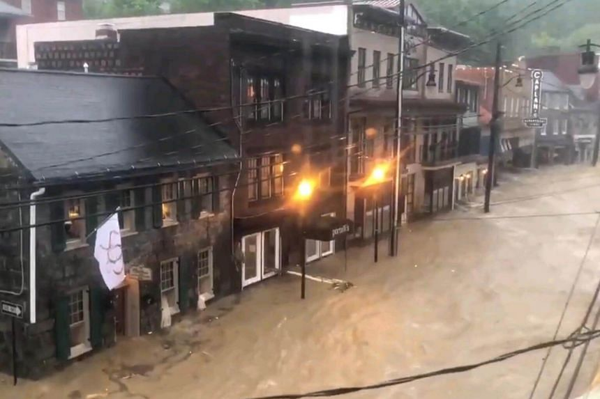 A SOS flag hanging from a building during flash flooding in the Main Street of Ellicott City, Maryland on May 27, 2018.