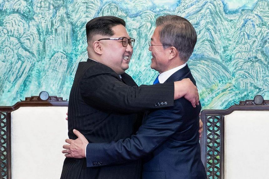 North Korea's leader Kim Jong Un (left) and South Korea's President Moon Jae hugging during a signing ceremony near the end of their historic summit at Panmunjom, on April 27, 2018.