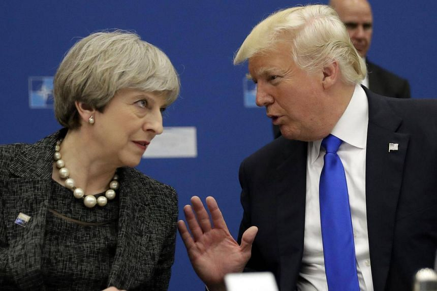 A file photo of US President Donald Trump (right) and British PM Theresa May at a meeting at the Nato summit in Brussels, on May 25, 2017.