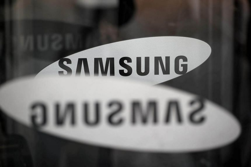 The logo of Samsung Electronics is seen at its office building in Seoul, on March 23, 2018.