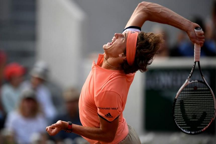 Germany's Alexander Zverev plays a return to Lithuania's Ricardas Berankis during their men's singles first round match on day one of The Roland Garros 2018 French Open tennis tournament in Paris on May 27, 2018.