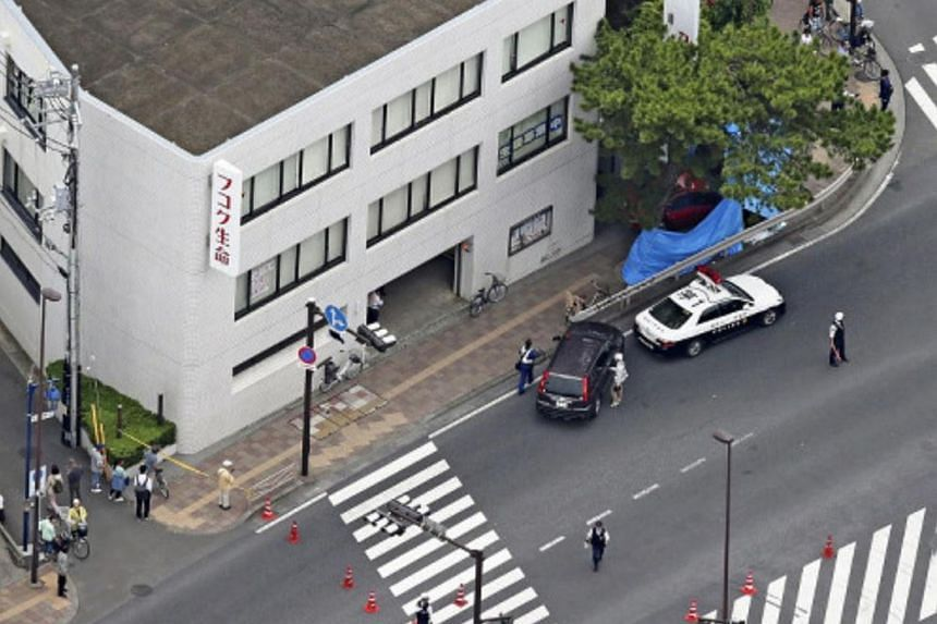 One woman was killed and three other pedestrians were injured when a red car driven by a 90-year-old woman mounted the kerb near a busy crossroads in Chigasaki city, Kanagawa prefecture, on May 28, 2018.