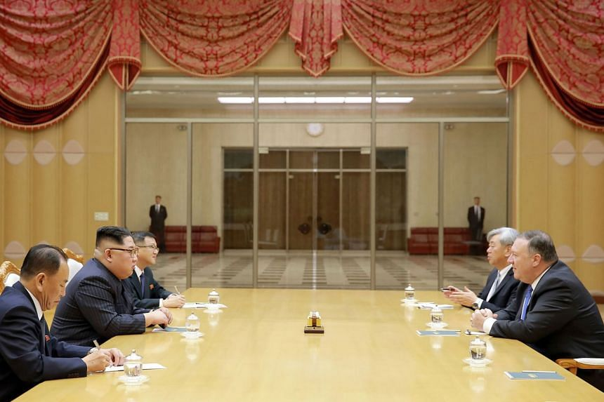 North Korean leader Kim Jong Un (second from left) meeting with US Secretary of State Mike Pompeo (right) at the Workers' Party of Korea headquarters in Pyongyang, on May 9, 2018.