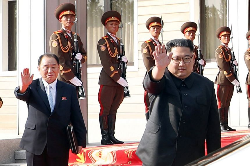 Mr Kim Jong Un and Mr Kim Yong Chol waving goodbye to Mr Moon after the summit, which was held on the North Korean side of the truce village.