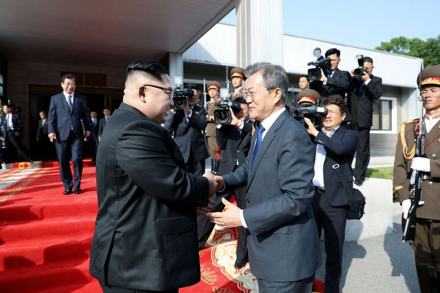 North Korean leader Kim Jong Un (left) and South Korean President Moon Jae In exchanging handshakes after their summit on the North's side of the truce village of Panmunjom last Saturday. Both sides said high-level inter-Korea talks have been sched