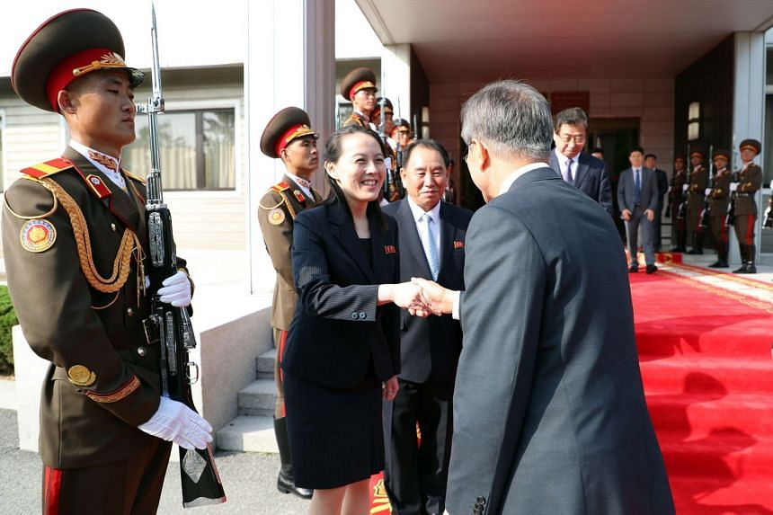 Mr Moon shaking hands with Mr Kim's sister, Ms Kim Yo Jong, following his meeting with the North Korean leader in Panmunjom.