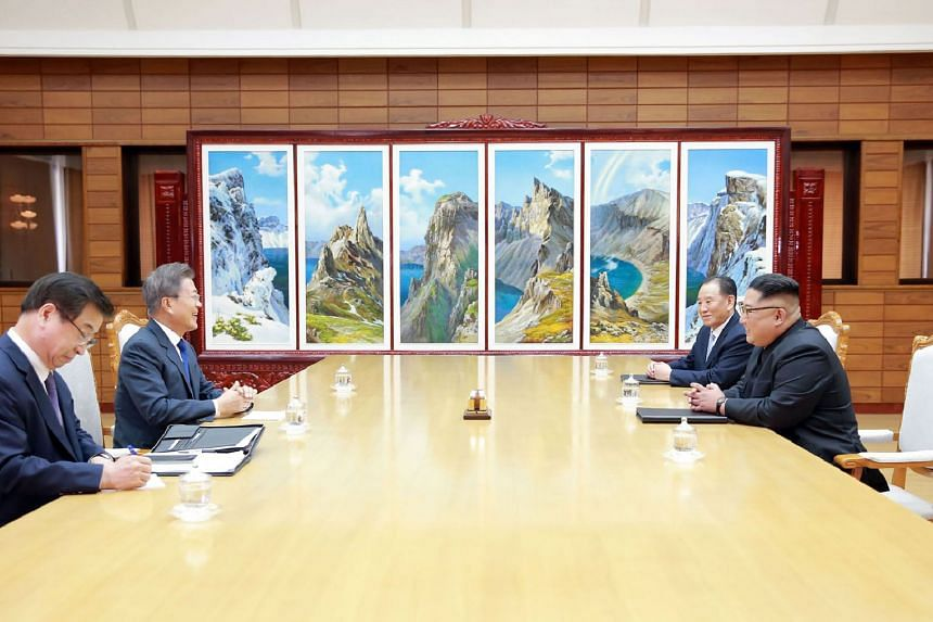 Mr Moon and Mr Kim during their meeting. With Mr Kim is Mr Kim Yong Chol, vice-chairman of the Workers' Party of Korea's central committee in charge of inter-Korean affairs.