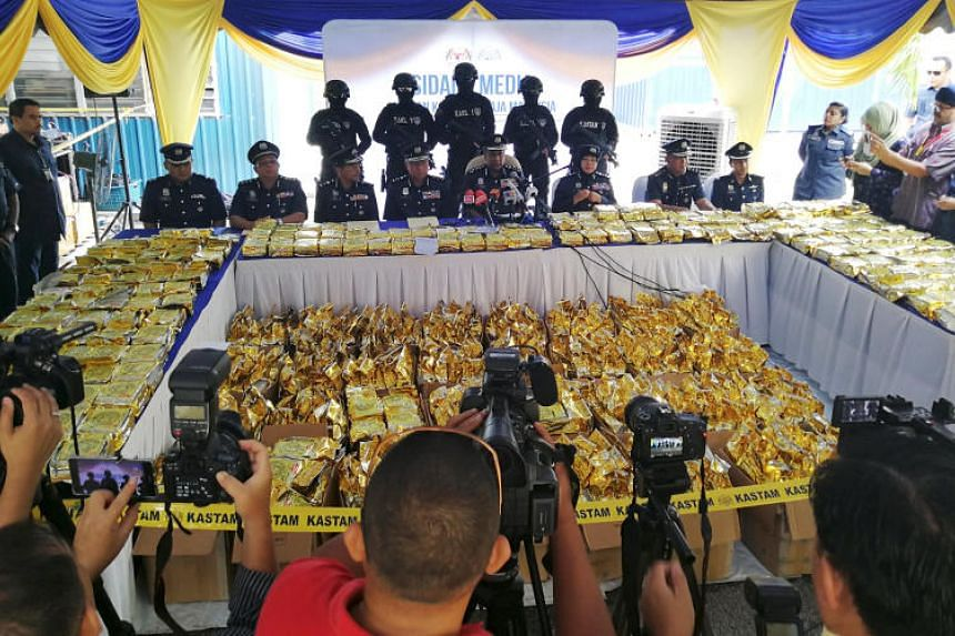 Customs officials displayed the shipment, packed in golden yellow tea packets, at its narcotics operations headquarters in Nilai, near Kuala Lumpur, on May 28, 2018.