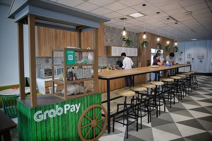 """The pantry of the Grab office at Marina One West Tower. The GrabFood delivery service was rolled out here yesterday and Grab Singapore head Lim Kell Jay (above) said it is a """"significant step"""" to serving the daily needs of consumers, beyond just tran"""