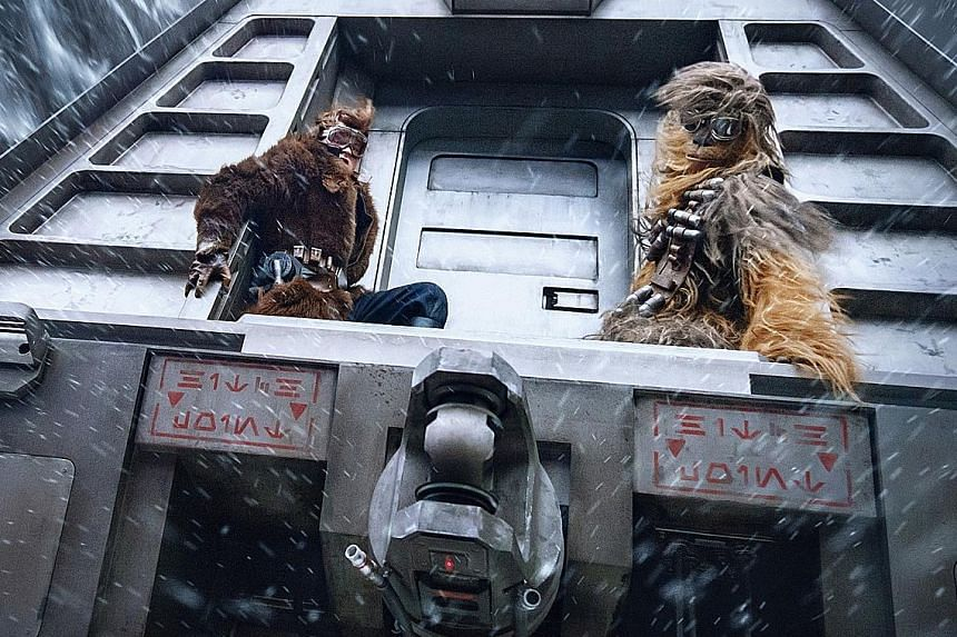 Solo: A Star Wars Story, starring Alden Ehrenreich as Han Solo and Joonas Suotamo as Chewbacca (both left), earned $111 million between Friday and Sunday in North America.