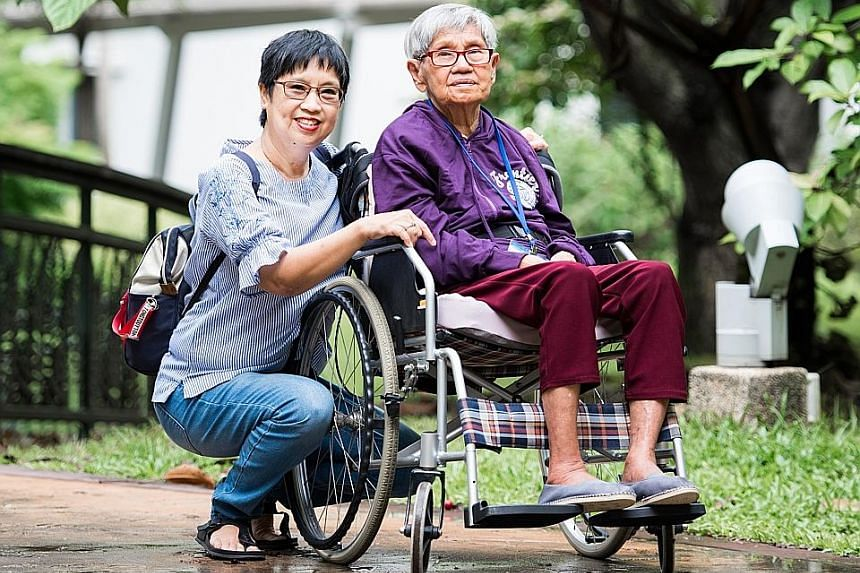 Madam Sarah Liew (far left) and her mother, Madam Quek Pong. Three years ago, Madam Liew was unable to find a GP willing to go to her mother's home to assess her for dementia.