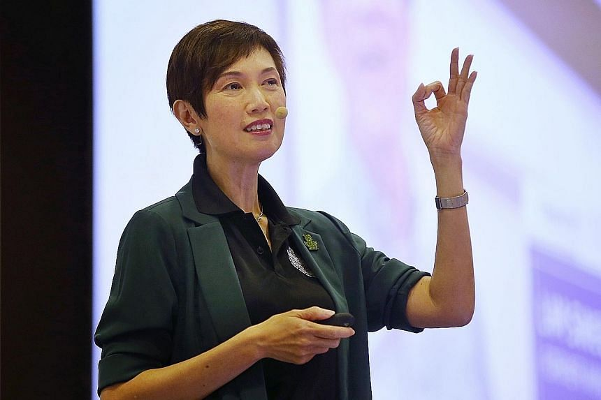 """Manpower Minister Josephine Teo (above), speaking at her ministry's Work Plan seminar yesterday, noted that labour MPs have raised the concerns of older workers (right), who """"have anxieties about the future, particularly as technology disrupts busine"""