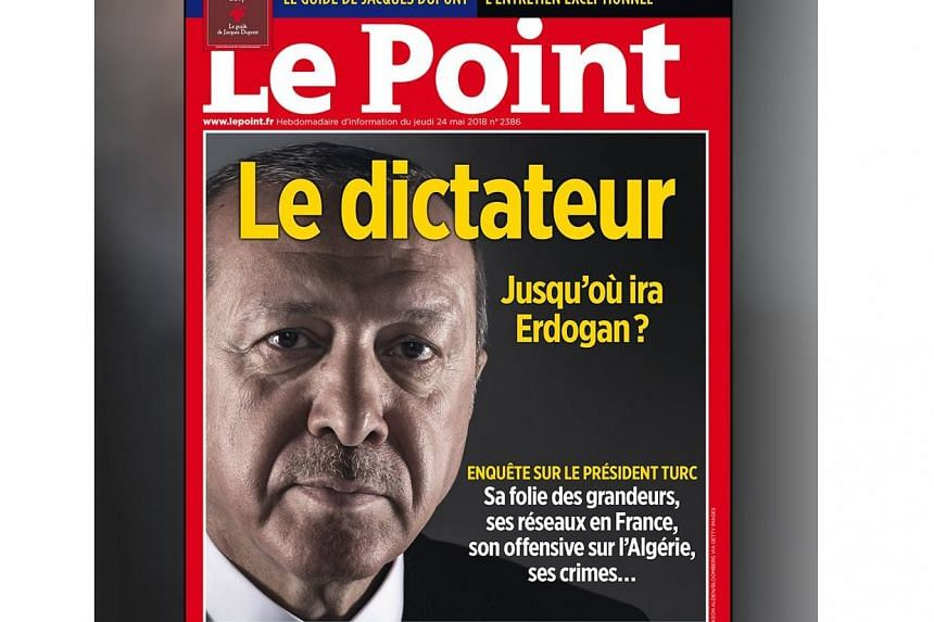 "A poster of the front cover - a portrait of Erdogan above the headline ""The Dictator. How far will Erdogan go?"" - was targeted at a newspaper kiosk in the town of Valence on May 27, 2018."