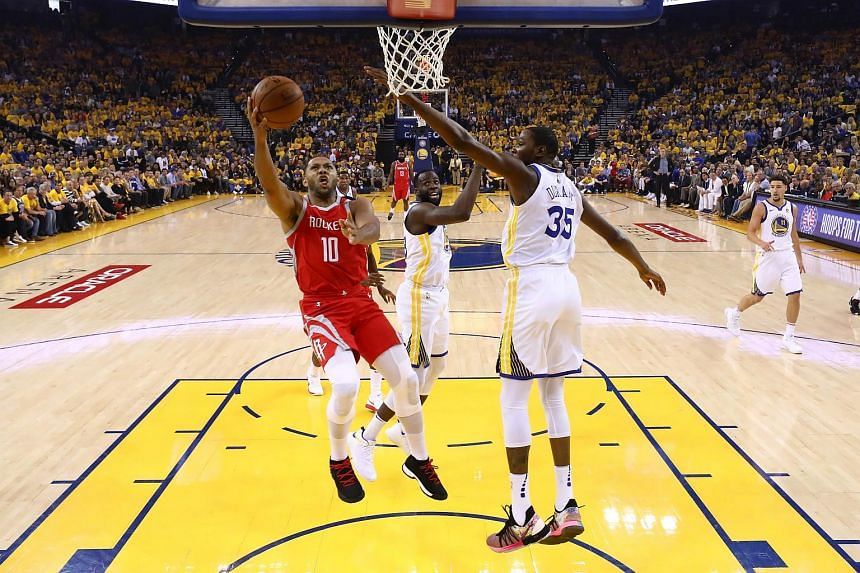 Eric Gordon #10 of the Houston Rockets goes up for a shot against the Golden State Warriors during Game Six of the Western Conference Finals in the 2018 NBA Playoffs at ORACLE Arena on May 26, 2018 in Oakland, California.