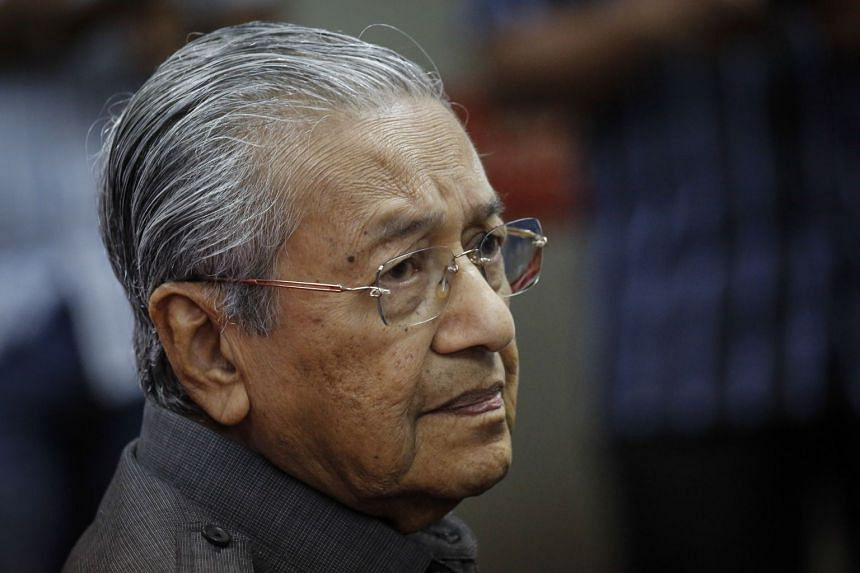 Malaysia's Prime Minister Mahathir Mohamad said there could be a penalty of 500 million for cancelling the project, but he was unsure if this was in ringgit or Singapore dollars.